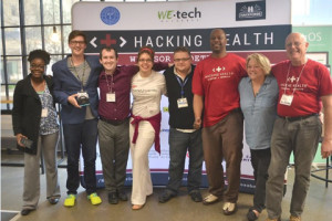 "Paula Lauren (fourth from left) competed at Hacking Health in Detroit last month, and received awards for her group's app, ""CarePRN."""